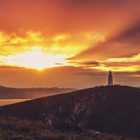Cape Bruny Lighthouse at sunset on Bruny Island Safaris tour