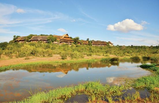 View of Victoria Falls Safari Lodge from the waterhole