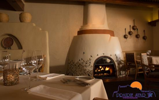 Prairie Star Restaurant & Wine Bar: Our handpainted and gold leafed kiva fireplace warms the room with ancient Anasazi design