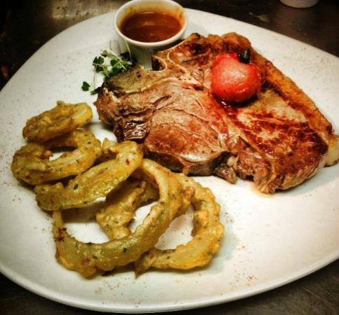 Cronins Restaurant : One of our many tasty specials , 14 oz Hereford T-Bone steak