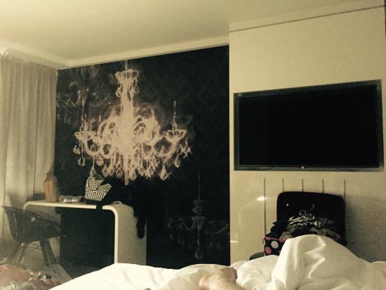 renaissance wien hotel very modern feeling decor in the room flat screen tv and