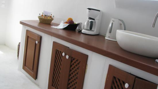 Perivolas: The kitchenette area with fruit, coffee and tea; a separate sink, counter, dishes, appliances, a