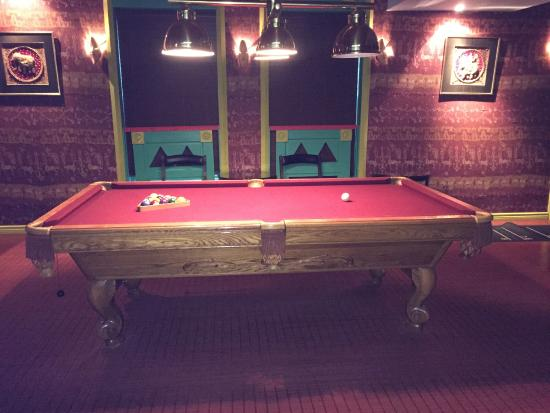 Games area with pool table and dartboard picture of for Pool spa show winnipeg