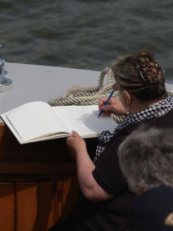 Betsie Jane River Tours: Drawing onboard as part of Linda Matthews' watercolour