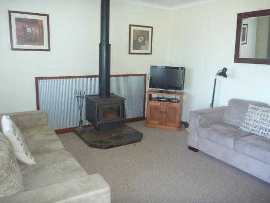 Montville Holiday Apartments: Lounge with wood fire and TV.