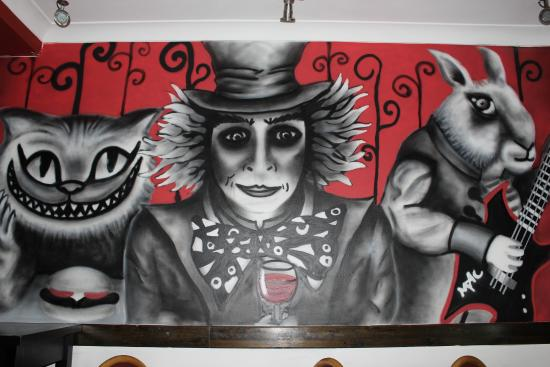 the mad hatter bar and grill graffiti wall
