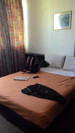 Oriental Hotel: This is double bed and the orange blanket is too old.