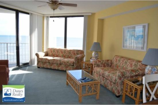 Condotels at One Ocean Place : A nice cozy spot to watch the school of dolphins go by.