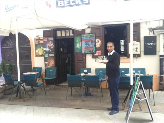 This is owner in working pose picture of cafe bar baza for Terrasse pronunciation