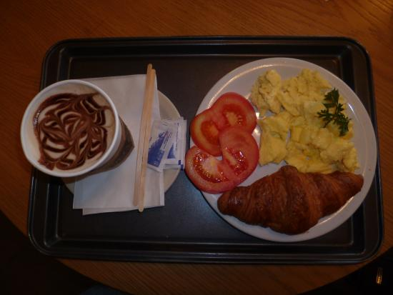 """Scrambled eggs, croissant and cappuccino at """"Granier Bakery"""" in Sunny Isles Beach"""