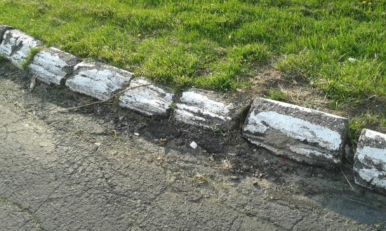 Ladd Brook Inn: Part of driveway- broken curbing
