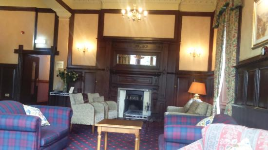 Loch Awe Hotel: hotel reception area with log fire