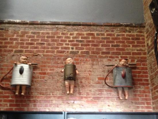 LuLu's: Creepy babies on the wall