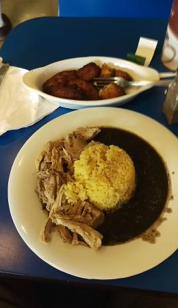 Nani's Restaurant: Piggy bowl...mojo pork, yellow rice and black beans, with plantains for lunch.
