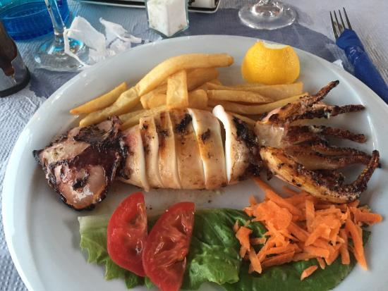 Poseidon Restaurant: The calamari is served as a whole squid which was a bit unexpected.