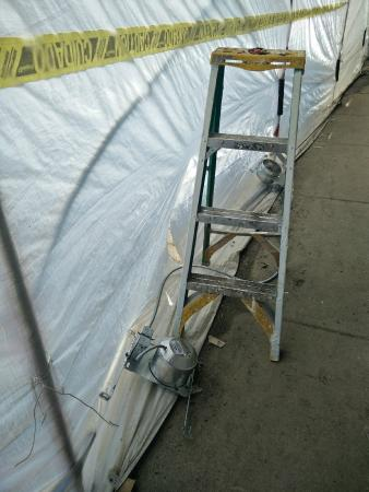Exterior covered by scaffolding & windows by opaque plastic