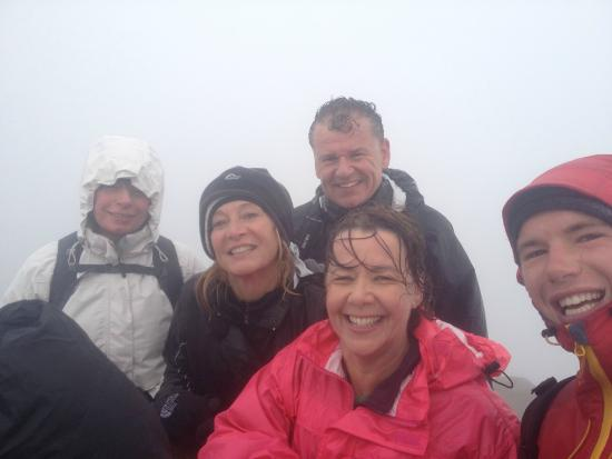 Llanberis, UK: Wet but happy to have reached the summit of Snowdon after their climb