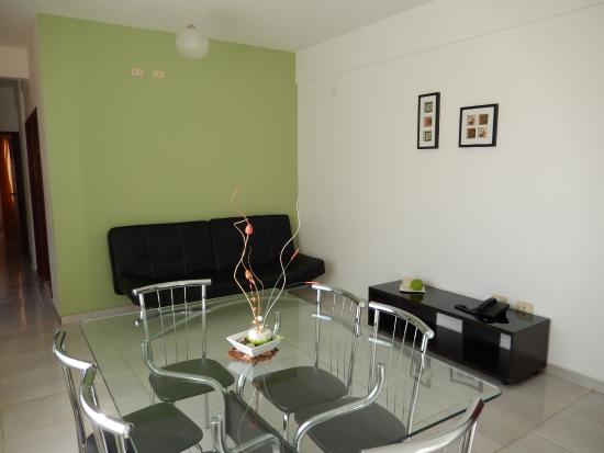 Sala /comedor Departamento Premium Doble - Picture of Aparthotel ...