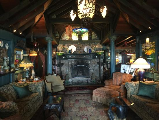 Lands End Inn: reading room with fireplace