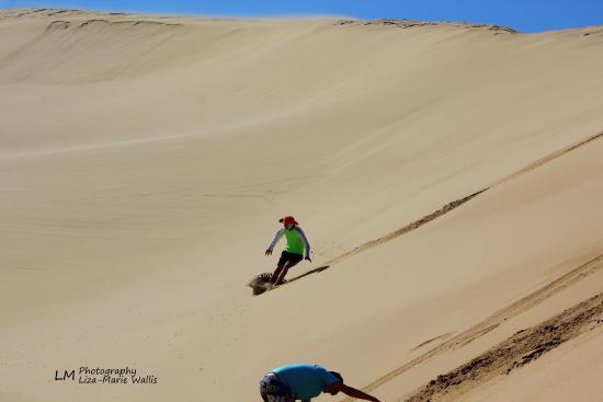 Boggomsbaai, แอฟริกาใต้: Sliding down sand Dunes at Kanon