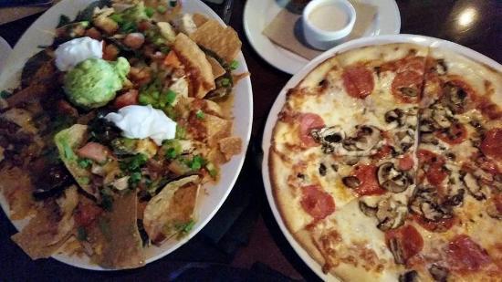 Yard House: Chicken nachos and pepperoni mushroom pizza -happy hour food