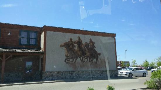Montana's BBQ & Bar: A 2 storey mural covers the side of the Montana restaurant