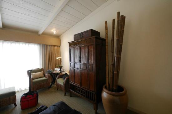 Tradewinds Carmel: TV armoire and urn with bamboo.