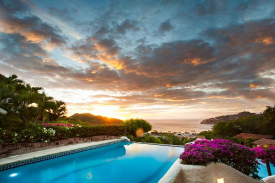 Pelican Eyes Resort & Spa: Stunning Sunset View from La Canoa Pool