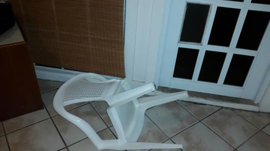 Hotel Kokomo: broken chair left in room like it belonged there
