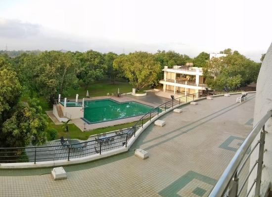 The jacuzzi above the pool picture of pluz resort - Hotels in silvassa with swimming pool ...