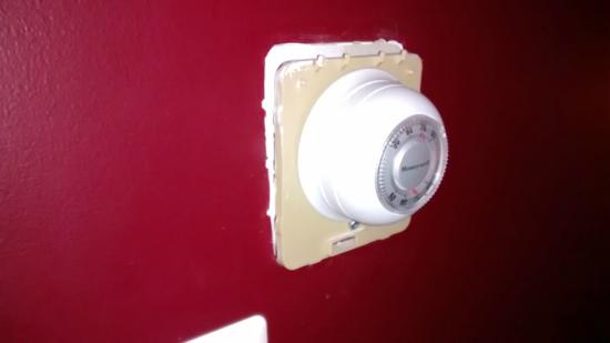 The Raven Art Hotel: Thermostat hangs loose