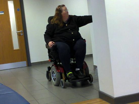 โบลตัน, UK: My wife with the power chair she uses