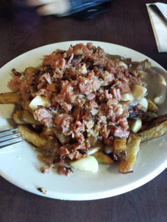 Dunn's Famous Deli : Pouting with smoked meat = fries with cheese curd gravy and chopped corned beef. Strange Canadia