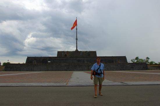 My husband in front of the flag tower