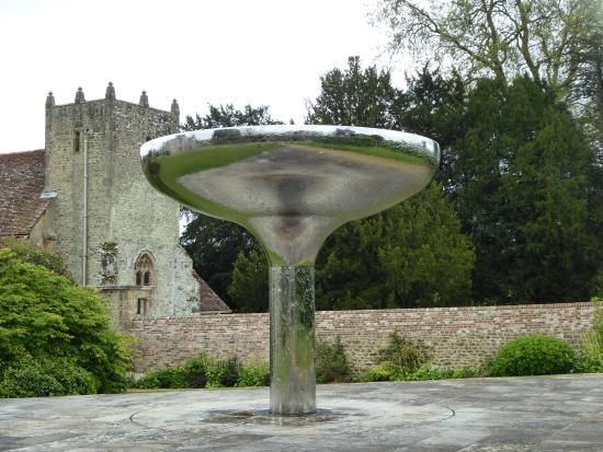 Woolbeding Gardens: water feature with church in the background