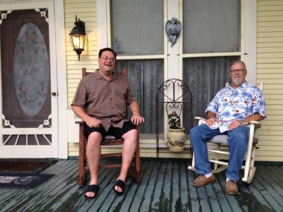 Angel Rose Bed & Breakfast: Ricky & Rusty on the porch the morning after the storm