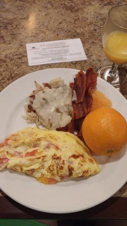 DoubleTree Suites by Hilton Orlando - Disney Springs Area: yummy breakfast, made to order omelettes and hashbrowns and gravy bacon fresh fruit.