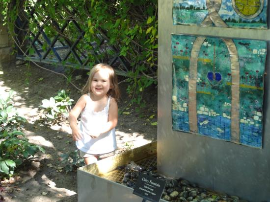 Idaho Botanical Garden: My daughter enjoying the art that is scattered among the nature