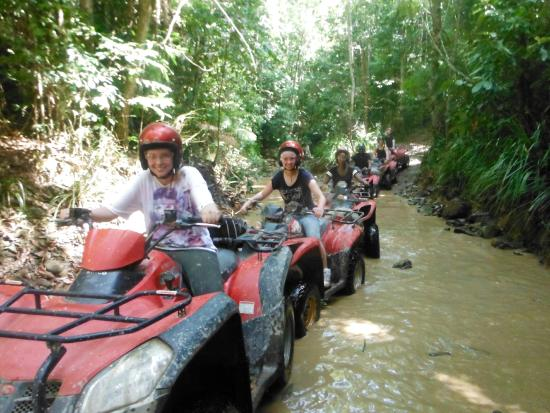 Down and Dirty Quad Bike Tours : The puddles make it more fun!