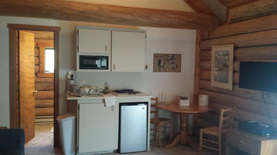 Triangle C Ranch : Kitchenette after cleaning up dishes. Facing back of cabin towards bathroom & closet. Note flat