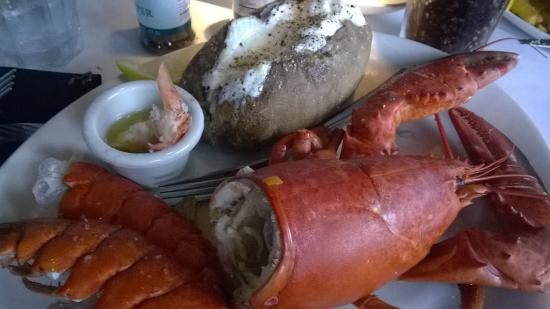 Landry's Seafood House : Lobster opps started eating it already!!!