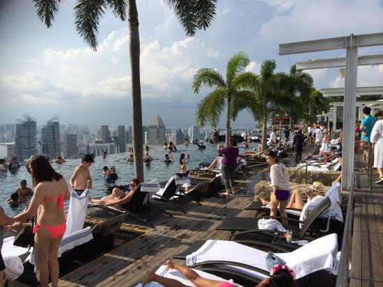 infinity pool in evening super crowded picture of marina bay sands singapore tripadvisor