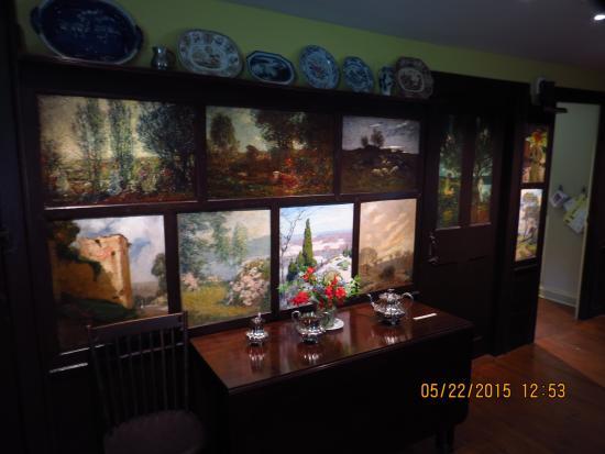 https://media-cdn.tripadvisor.com/media/photo-s/07/f9/73/f0/artwork-on-panels-in.jpg