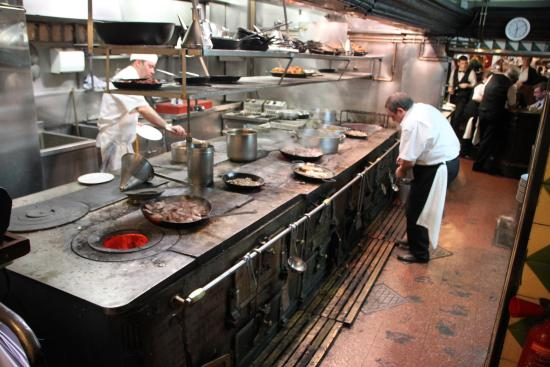 Busy Restaurant Kitchen you walk through the busy kitchen to get to your table. - picture