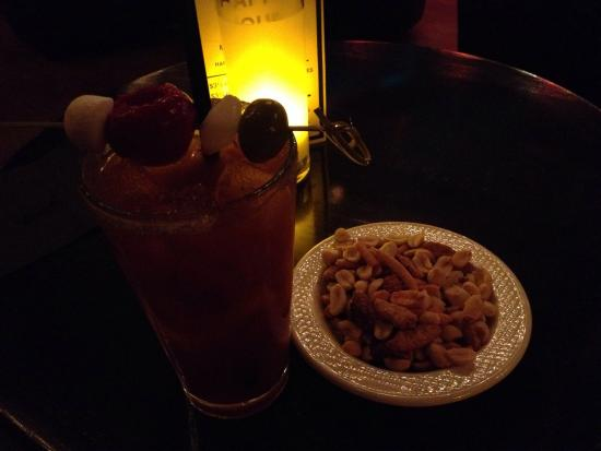 Foxy's Fine Food & Drinks : Foxy's cut filet mignon and double caesar with complimentary mixed nuts.