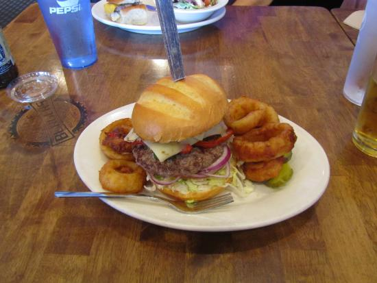Big House Burgers & Bottlecap Bar : Jalapone Bugrer with onion rings.