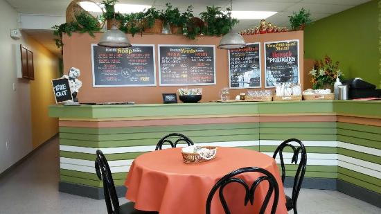 Teremok Cafe : The counters and clean, and show off the great menus on the walls behind.