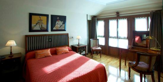 Apartamentos Turísticos 3 llaves  LA  PONTIGA: dormitorio