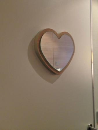 Odd small heart shape mirror on the outside of the Odd shaped mirrors