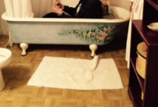 Grand Living Bed & Breakfast: The Rose Rooms namesake claw-foot tub.
